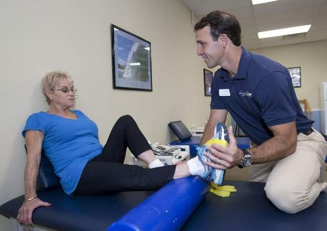 Mike Manzo, a physical therapist who owns Atlantic Physical Therapy Center with his brother Dave, works with client Yvonne Cohn, Brick, in their Howell office.